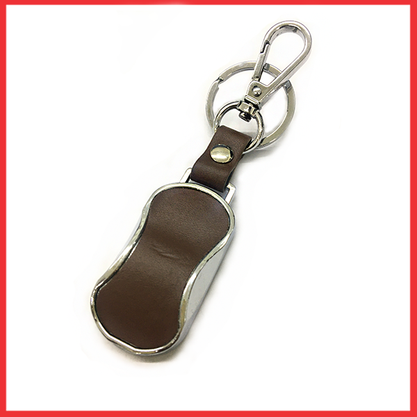 Silver And Metal Keychain With Brown Leather