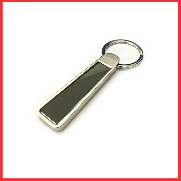 Silver And Metal Keychain And Black Glass