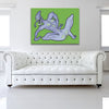 Tulip The Sex Pest Bright Green Canvas shown on a wall in a white room with sofa