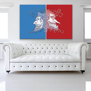 Face Off Blue And Red Canvas Diptych shown facing away on a wall in a white room with sofa
