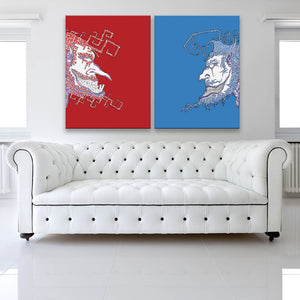Face Off Red And Blue Canvas Diptych shown facing toward on a wall in a white room with sofa