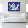Mint And Blueberry Flavoured Tulip Blue Canvas shown on a wall in a white room with sofa