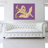 Orange And Plum Flavoured Tulip Purple Canvas shown on a wall in a white room with sofa