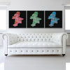Running Man Red, Blue, And Green Canvas Triptych shown on a wall in a white room with sofa