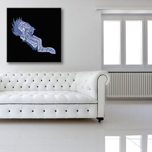 Screaming Blue Head Black Canvas shown on a wall in a white room with sofa