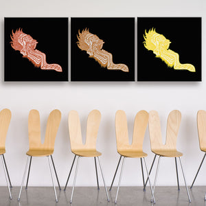 Screaming Heads In The Day Red, Orange, And Yellow Canvas Triptych shown on a wall in a room with chairs