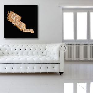 Screaming Orange Head Black Canvas shown on a wall in a white room with sofa