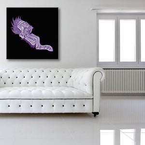 Screaming Purple Head Black Canvas shown on a wall in a white room with sofa