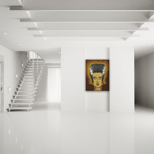 Classic Horror: Bride Of Frankenstein Canvas Art shown on a wall in a modern white minimalist room
