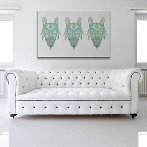 Trio Of Devils White & Green Canvas Art shown on a wall in a white room with sofa
