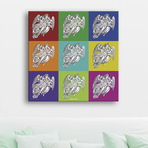 Angels Canvas shown on a wall in a room with cushions