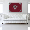 Death Head Oxblood Canvas shown on a wall in a white room with sofa