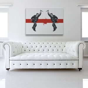 Do Unto Others Canvas shown on a wall in a white room with sofa