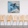 Formal Skiing Canvas shown on a wall in a room with chairs