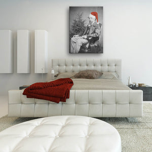 Oh! The Joys Of Christmas Canvas shown hung on a wall in a contemporary bedroom