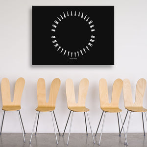 Open Wide Black And White Rectangular Canvas shown on a wall in a room with chairs