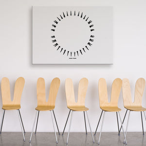 Open Wide White And Black Rectangular Canvas shown on a wall in a room with chairs