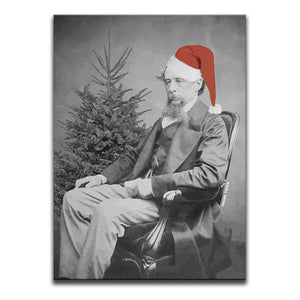 Canvas Wall Art featuring a black and white image of Charles Dickens wearing a Santa Hat sat in front of a Christmas Tree looking miserable. Artwork by Indian Taker