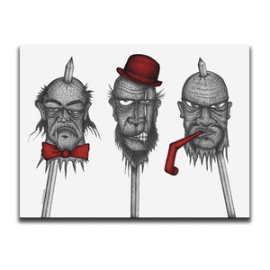 Horror themed Canvas Wall Art featuring a red accented dark art image of three spiked heads against a white background. Artwork by Broken Babies