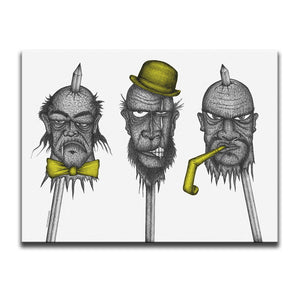 Horror themed Canvas Wall Art featuring a yellow accented dark art image of three spiked heads against a white background. Artwork by Broken Babies