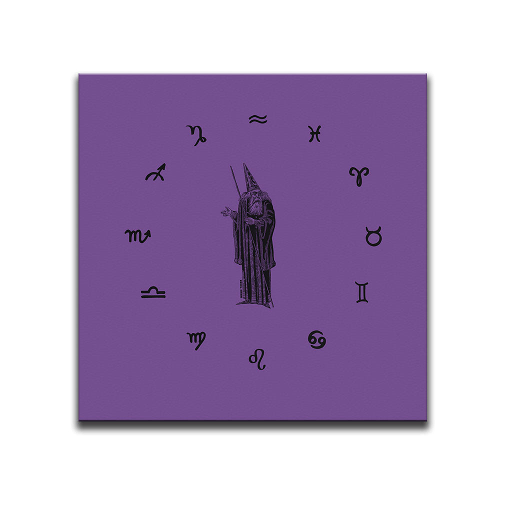 Canvas Wall Art featuring an engraved image of a wizard and a circle of zodiac symbols illustrated in a printmaking style over a purple background. Artwork by Indian Taker
