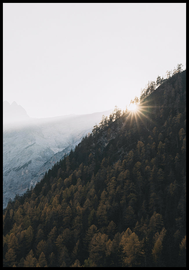 Sun by mountain