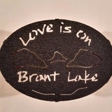 Text Love is on Brant Lake text with the outline of the lake and surrounding Adirondack mountainscap