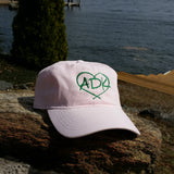 Ball cap with our ADK in a heart silhouette logo.  Pink hat with green embroidery..