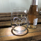 Clear stemless wine glass with our GF logo inside a heart.