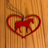 Horse in a heart ornament with a metal hanger; red.