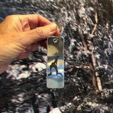 The silhouette of Loon Lake etched using a permeable process on a stainless key chain.