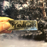 Friends Lake written out on a stainless key chain.