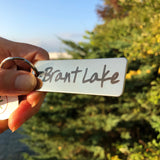 Brant Lake text on a stainless key ring.