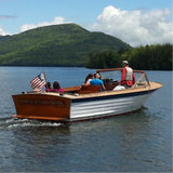 Photo of a 26' Lyman wooden boat with people riding in it, on Lake George.