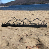 Love is on Schroon Lake text on Black Metal shelf sitter with the mountains.
