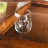 Clear stemless wine glass with a lake and mountain scene.  Text reads Love is on Schroon Lake