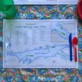 Disposable placemat including a map of the Islands of Lake George  including some fun facts. One-sided; white background, blue lake and green islands with the map of the South Basin.