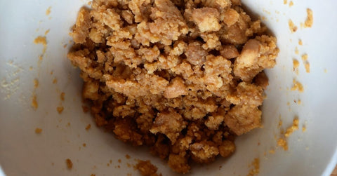 Melted butter and biscuit crumbs combined for the cheesecake base