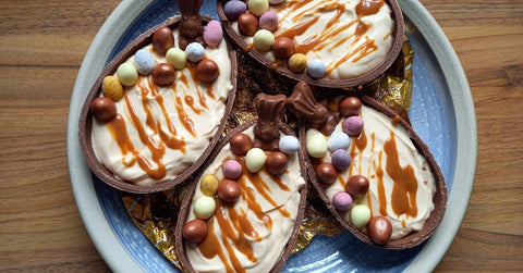 Easter egg caramel cheesecakes with mini egg decoration, ready to eat