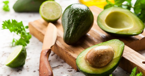 Avocado halves with lime
