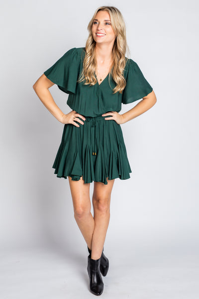 Solid Surplice Mini Dress in Green