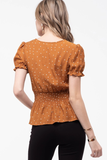 Dotted Surplice Peplum Top in Rust