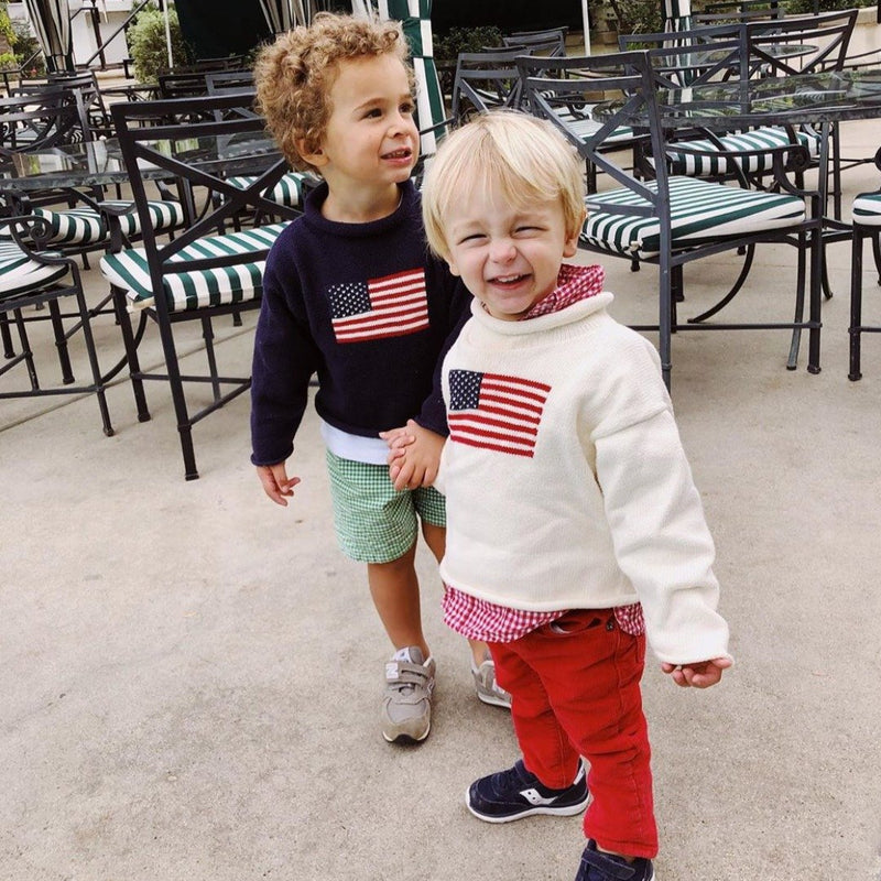 Two boys wearing American Flag rollneck sweaters