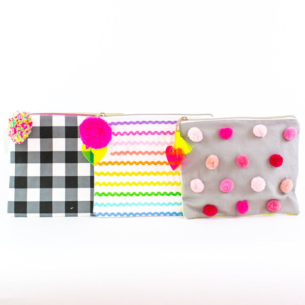 Patterned zip monogram pouches