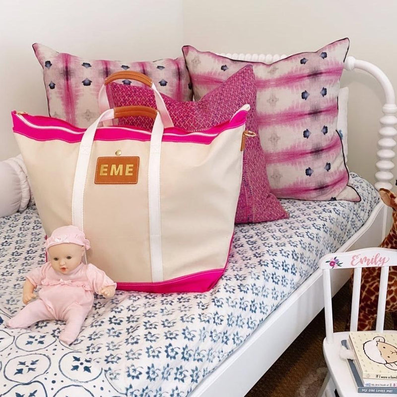 Avery Coated Canvas Jumbo Tote - Pink - shown on bed