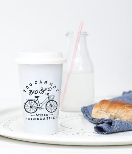 You cannot be sad while riding a bike - Ceramic Travel Mug - Sovende Bjorn