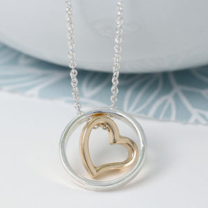Yellow gold heart in silver plated circle necklace