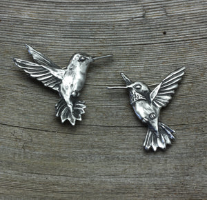 A pair of Hummingbird brooches