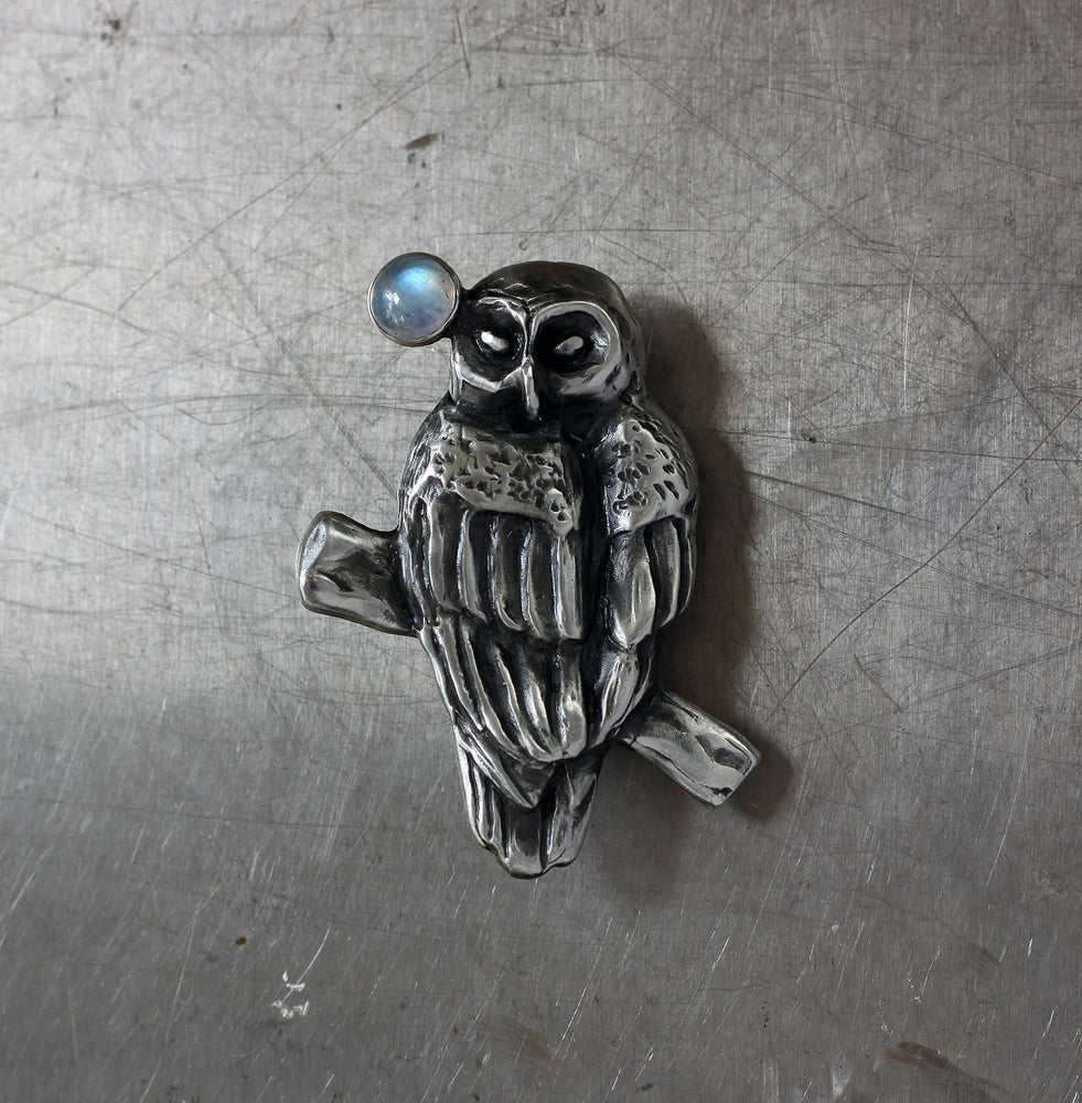 Owl with moonstone brooch