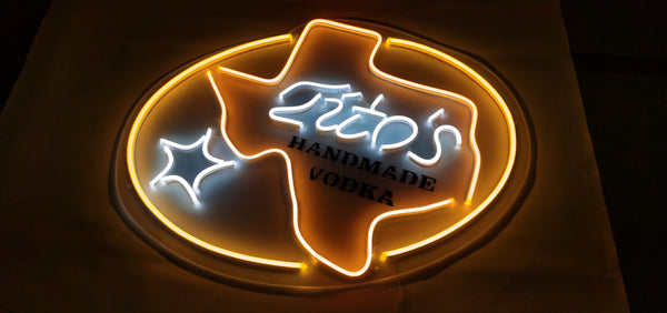 tito's neon sign on